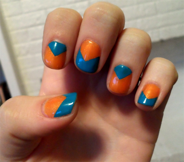blue and orange reverse chevron nail polish manicure