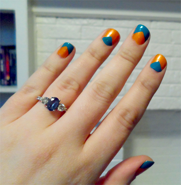 blue and orange triangle manicure