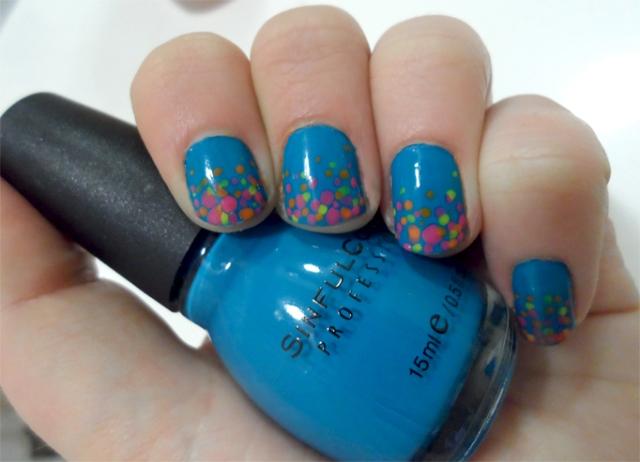 blue neon confetti manicure