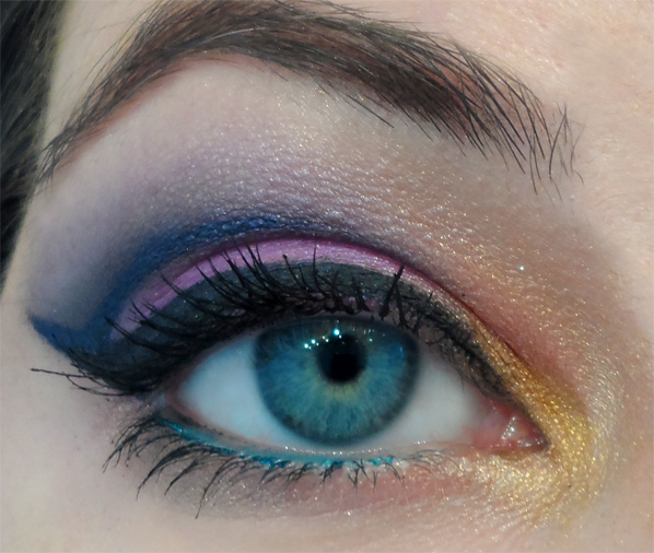 dramatic blue and pink winged cut crease liner
