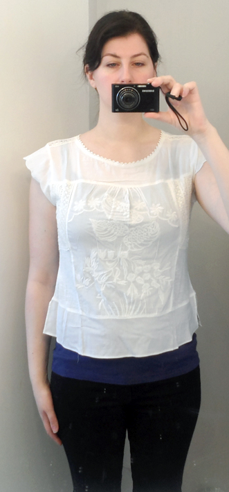 in clover white embroidered top