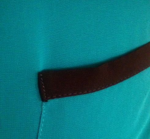 teal naked zebra crepe blouse fabric detail