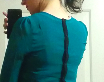 teal naked zebra crepe blouse with button back